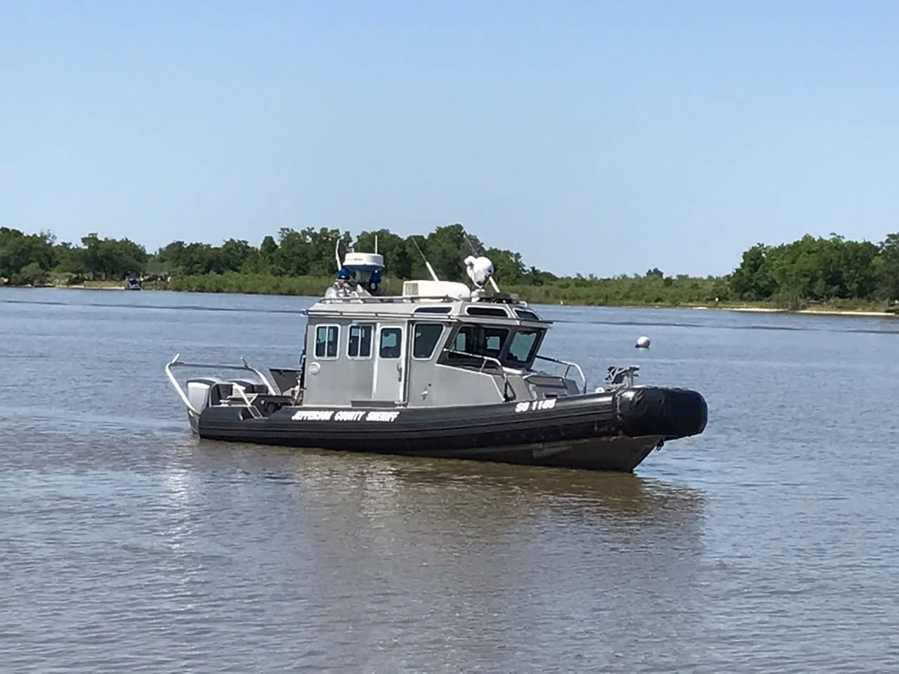Jefferson County Sheriff's Patrol Boat going down a river.