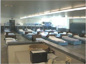 Large room with many beds.