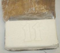 A rectangle brick of heroin wrapped in plastic with the number 11 embossed in it.