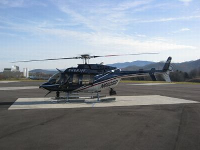 Jefferson County Sheriff's helicopter on a runway.