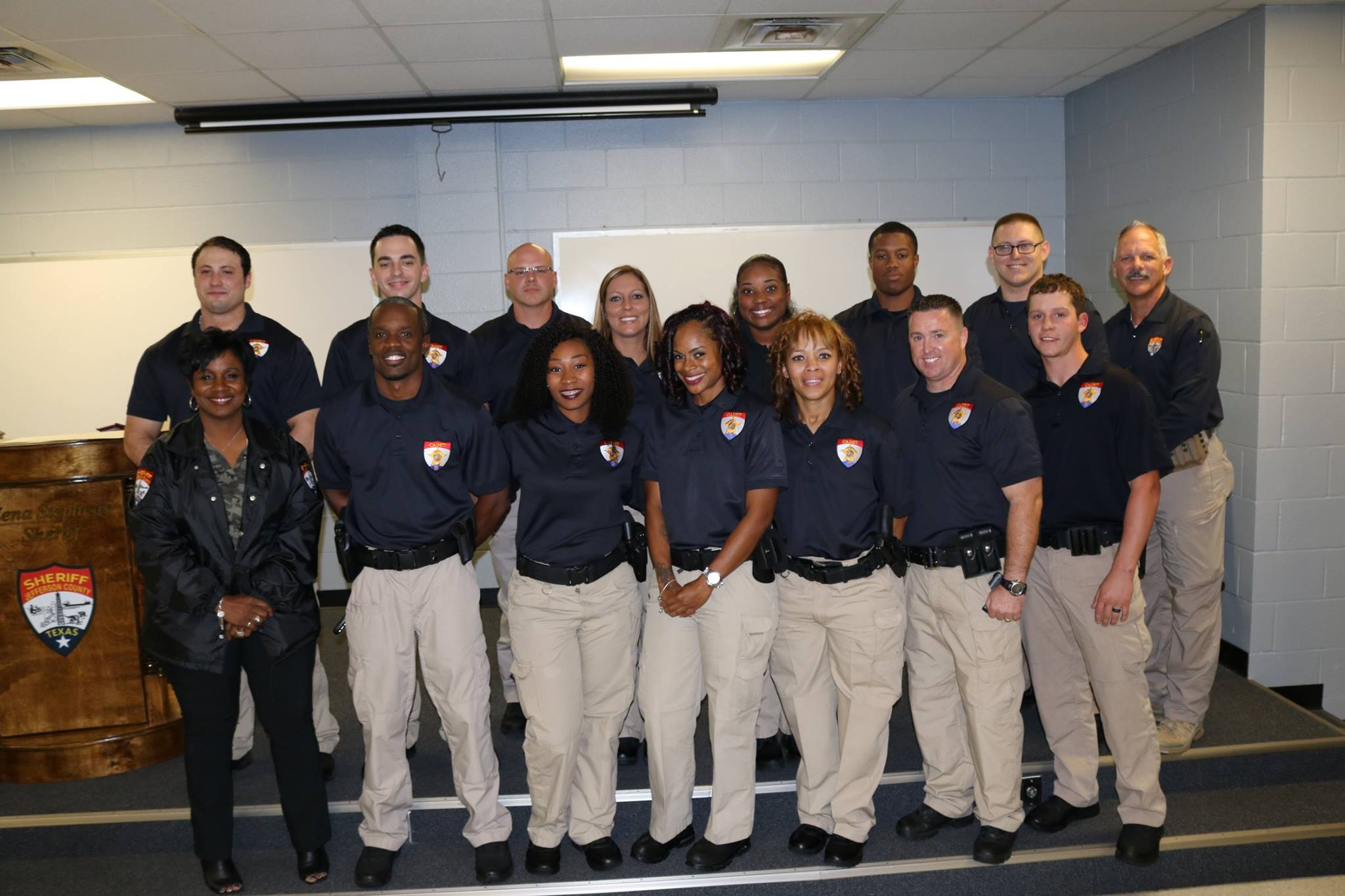 A group photos of deputy trainees with Sheriff Zena Stephens.